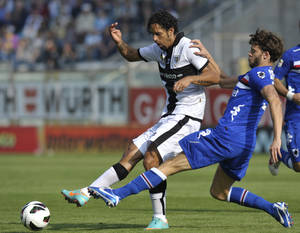 Photo -   Parma's Carvalho Amauri of Brazil, left, vies for the ball with Sampdoria's Andrea Costa, during their Serie A soccer match at Parma's Tardini stadium, Italy, Sunday, Oct. 21, 2012. (AP Photo/Marco Vasini)