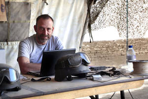 "Photo - In this photo released by Spanish newspaper El Periodico de Catalunya on Sunday March 2, 2014, journalist Marc Marginedas who works for the newspaper, sits by his laptop at the Canadian base in Nakhonay, Afganistan in this photo taken on Oct. 10, 2010. Marginedas, who was kidnapped by al-Qaida-linked militants in Syria crossed the border into Turkey on Sunday March 2, 2014  his newspaper reported, as activists said government airstrikes killed at least 13 people in a northwestern border town. Veteran war correspondent Marc Marginedas was abducted on Sept. 4 near Hama by jihadists belonging to the Islamic State of Iraq and the Levant, a breakaway al-Qaida group. He was ""moved repeatedly"" while in captivity and was accused of spying for the West before his release, his newspaper El Periodico said. (AP Photo/Agustin Catalan, El Periodico de Catalunya)"