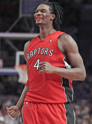 Photo - Thunder fans may fantasize about Raptors forward Chris Bosh in Oklahoma City, but it isn't likely to happen. AP PHOTO
