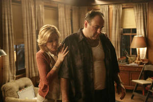 """Photo - FILE - In this file photo, originally released by HBO in 2007, Edie Falco portrays Carmela Soprano and James Gandolfini is Tony Soprano in a scene from one of the last episodes of the hit HBO dramatic series """"The Sopranos."""" Amazon is teaming up with HBO, the first such streaming arrangement agreed to by the cable network, in a deal that will make available to Amazon Prime members some classic TV like """"The Sopranos"""" and """"The Wire."""" (AP Photo/HBO, Craig Blankenhorn, File)"""