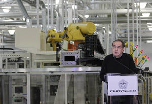 photo - Chrysler Group LLC Chairman and CEO Sergio Marchionne announces a $374 million investment in two Indiana plants at an investment and jobs announcement event at the Chrysler transmission plat in Kokomo, Ind., Thursday, Feb. 28, 2013. Chrysler said Thursday it will invest nearly $400 million and create 1,250 new jobs at transmission and metal casting factories in the Kokomo, Indiana, area. (AP Photo/AJ Mast)
