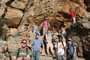 Photo - High school students who participated in the 2012 Paleo Expedition sponsored by the Sam Noble Oklahoma Museum of Natural History pose on the side of a mountain. PHOTOS PROVIDED