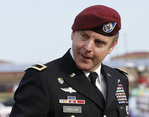 Photo - Brig. Gen. Jeffrey Sinclair, who admitted to inappropriate relationships with three subordinates, arrives at the courthouse for sentencing at Fort Bragg, N.C., Thursday, March 20, 2014.  Sinclair was reprimanded and docked $20,000 in pay Thursday, avoiding jail time in one of the U.S. military's most closely watched courts-martial.(AP Photo/Ellen Ozier)