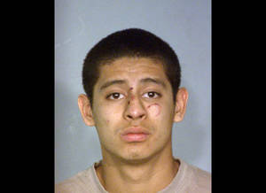 Photo - This photo provided by the Nevada Highway Patrol shows Jean Soriano, 18, who was booked into the Clark County Detention Center after he was treated and released at University Medical Center in Las Vegas. Soriano has been arrested on suspicion of driving under the influence in a southern Nevada crash that killed five members of a California family and injured the suspect and three other people. (AP Photo/Nevada Highway Patrol)