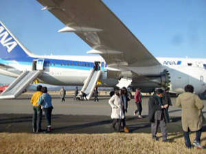 photo - In this photo taken by a passenger and distributed by Japan's Kyodo News, passengers leave an All Nippon Airways Boeing 787 after it made an emergency landing at Takamatsu airport in Takamatsu, Kagawa Prefecture, western Japan, Wednesday, Jan. 16, 2013. ANA said a cockpit message showed battery problems and a burning smell was detected in the cockpit and the cabin, forcing the 787 on a domestic flight to land at the airport. (AP Photo/Kyodo News) JAPAN OUT, MANDATORY CREDIT, NO LICENSING IN CHINA, HONG KONG, JAPAN, SOUTH KOREA AND FRANCE