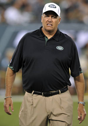 Photo -   FILE - In this Aug. 26, 2012, file photo, New York Jets head coach Rex Ryan walks on the field before a preseason NFL football game against the Carolina Panthers in East Rutherford, N.J. The Jets' defense, featuring an improved secondary, is shaping up to be one of the toughest in the league but is being overshadowed by a quarterback controversy and the offense's inability to get into the end zone. The Jets are scheduled to begin their regular season on Sept. 9 at home against the Buffalo Bills. (AP Photo/Bill Kostroun, File)