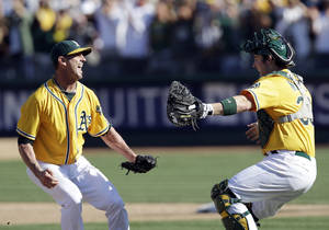 photo -   Oakland Athletics relief pitcher Grant Balfour, left, and catcher Derek Norris celebrate after their 12-5 win over the Texas Rangers in a baseball game, Wednesday, Oct. 3, 2012 in Oakland, Calif. The A&#039;s clinch the AL West title with the win. (AP Photo/Marcio Jose Sanchez)  