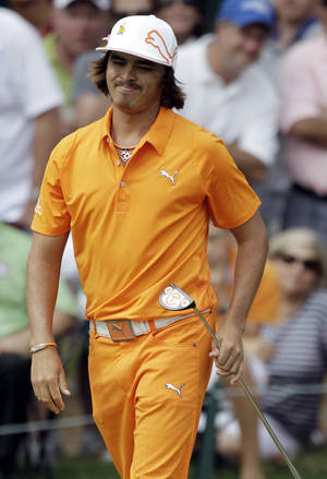 Photo - Rickie Fowler reacts after making par on the eighth hole during the final round of the Players Championship golf tournament at TPC Sawgrass, Sunday, May 13, 2012, in Ponte Vedra Beach, Fla. (AP Photo/John Raoux) ORG XMIT: XPVB135