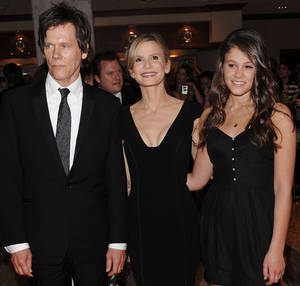 Photo - FILE - In this May 9, 2009 file photo, actors Kevin Bacon, left, and Kyra Sedgwick, center, pose with their daughter Sosie Bacon at the 2009 White House Correspondents' Association Dinner at the Washington Hilton, in Washington. The Hollywood Foreign Press Association has selected the actress Sosie Bacon as Miss Golden Globe 2014 for the 71st Annual Golden Globe Awards.  It was announced by the HFPA Thursday, Nov. 21, 2013, at an event held at Fig and Olive in West Hollywood, Calif. (AP Photo/Evan Agostini)