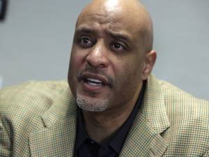 Photo - New baseball union head Tony Clark is interviewed at the organization's headquarters, in New York,  Wednesday, Jan. 15, 2014. Clark says players won't agree to terminating contracts as part of discipline for drug violations. Clark took over as the union's executive director following the death of Michael Weiner in November. (AP Photo/Richard Drew)