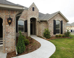 photo - Harbor Homes Inc. of Norman finished this house earlier this year at 308 SW 171 in the Talavera addition. Photo by PAUL B. SOUTHERLAND, The Oklahoman
