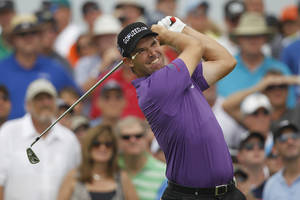 Photo -   Padraig Harrington of Ireland watches his shot from the 17th tee during the second round of the PGA Championship golf tournament on the Ocean Course of the Kiawah Island Golf Resort in Kiawah Island, S.C., Friday, Aug. 10, 2012. (AP Photo/Lynne Sladky)