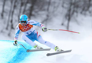 Photo - Austria's gold medalist Matthias Mayer makes a turn in the men's downhill at the Sochi 2014 Winter Olympics, Sunday, Feb. 9, 2014, in Krasnaya Polyana, Russia. (AP Photo/Alessandro Trovati)