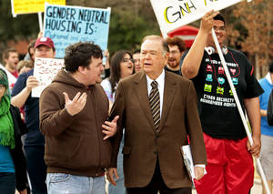 Photo - President David L. Boren walks and listens to student protestors in favor of gender neutral housing on the Campus on the South Oval of the University of Oklahoma on Wednesday, March 7, 2012, in Norman, Okla.  Photo by Steve Sisney, The Oklahoman