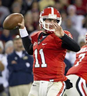 photo -   FILE - In this Nov. 27, 2010, file photo, Georgia quarterback Aaron Murray throws a pass during the first half of an NCAA college football game against Georgia Tech in Athens, Ga. Murray believes the No. 6 Bulldogs will be better prepared for the fast-paced no-huddle offense this season. (AP Photo/Rich Addicks,aFile)  