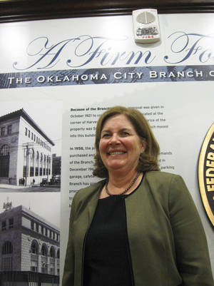 photo - Esther George, president of the Kansas City Federal Reserve Bank, stands Tuesday in the lobby of the bank's Oklahoma City branch. Photo by DON MECOY, THE OKLAHOMAN