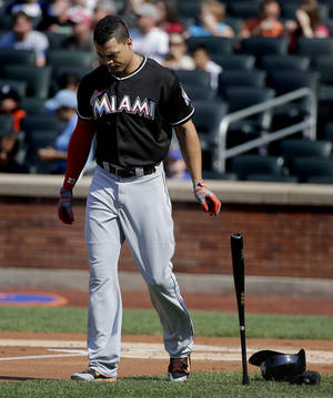Photo - Miami Marlins' Giancarlo Stanton drops his bat after striking out against the New York Mets to end the top of the first inning of a baseball game, Saturday, July 12, 2014, in New York. (AP Photo/Julie Jacobson)
