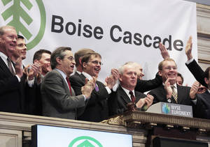 photo - Boise Cascade Chief Executive Officer Thomas Carlile, second from right, joined by members of the companyís executive management team, rings the opening bell of the New York Stock Exchange, on Wednesday to celebrate their IPO.  AP Photo