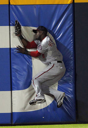 Photo -   Washington Nationals left fielder Roger Bernadina crashes into the wall after making a catch to retire Atlanta Braves' Jason Heyward in the fifth inning of a baseball game on Friday, Sept. 14, 2012, in Atlanta. Bernadina was shaken up on the play but stayed in the game. (AP Photo/John Bazemore)