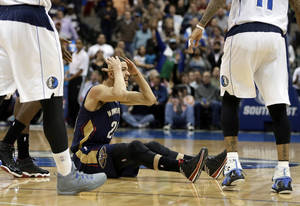 Photo - New Orleans Pelicans' Austin Rivers (25) reaches to his head with his hands after looking for a foul call against the Dallas Mavericks as time ran in the second half of an NBA basketball game, Saturday, Jan. 11, 2014, in Dallas. The Mavericks won 110-107. (AP Photo/Tony Gutierrez)