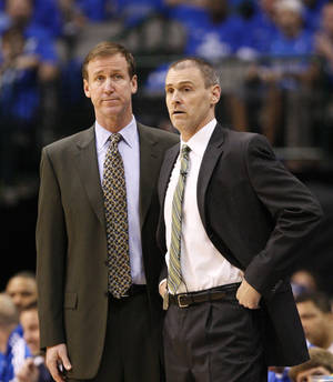 Photo - In this May 25, 2011, photo, Dallas Mavericks assistant coach Terry Stotts, left, and coach Rick Carlisle watch Game 5 of the NBA Western Conference finals basketball series against the Oklahoma City Thunder in Dallas. The Portland Trail Blazers have hired Stotts as coach. The move announced Tuesday, Aug. 7, 2012, by Trail Blazers general manager Neil Olshey fills the NBA's last coaching vacancy. (AP Photo/Tony Gutierrez) ORG XMIT: NY168