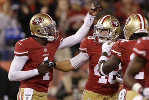photo -   San Francisco 49ers quarterback Josh Johnson (1) celebrates after throwing a touchdown pass to tight end Garrett Celek (48) during the second half of an NFL preseason football game against the San Diego Chargers in San Francisco, Thursday, Aug. 30, 2012. (AP Photo/Marcio Jose Sanchez)