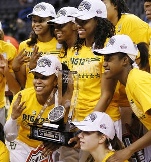 Photo - Baylor players pose for a photo with the championship trophy after the Big 12 women's basketball tournament championship game between Baylor and West Virginia at the Chesapeake Energy Arena in Oklahoma City, Monday, March 10, 2014. Baylor won, 74-71. Photo by Nate Billings, The Oklahoman