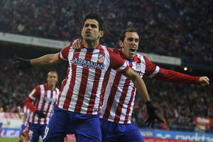 Photo - Atletico's Diego Costa, left, celebrates his goal with Diego Godin, right, during a Spanish La Liga soccer match between Atletico de Madrid and Levante at the Vicente Calderon stadium in Madrid, Spain, Saturday, Dec. 21, 2013. (AP Photo/Andres Kudacki)