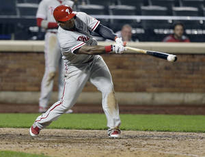 Photo - Philadelphia Phillies' Marlon Byrd hits an RBI double during the eleventh inning of a baseball game against the New York Mets, Friday, May 9, 2014, in New York. (AP Photo/Frank Franklin II)
