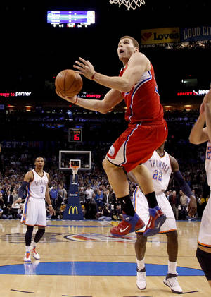 Photo - Los Angeles' Blake Griffin (32) goes to the basket during the NBA basketball game between the Oklahoma City Thunder and the Los Angeles Clippers at the Oklahoma CIty Arena, Tuesday, Feb. 22, 2011.  Photo by Bryan Terry, The Oklahoman
