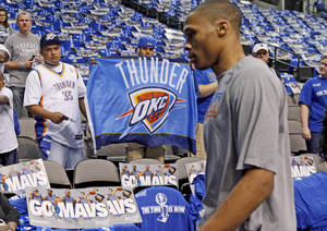 photo - Thunder fans Wayne Cogburn, right, and Alex Aguilar of Oklahoma CIty try to get the attention of Oklahoma City's Russell Westbrook before game 2 of the Western Conference Finals in the NBA basketball playoffs between the Dallas Mavericks and the Oklahoma City Thunder at American Airlines Center in Dallas, Thursday, May 19, 2011. Photo by Bryan Terry, The Oklahoman