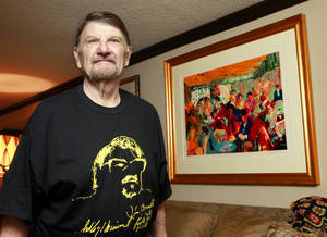 photo - Chef John Bennett with his LeRoy Nieman painting while wearing a T-shirt with the sketch Nieman did of Bennett years ago. <strong>David McDaniel - The Oklahoman</strong>