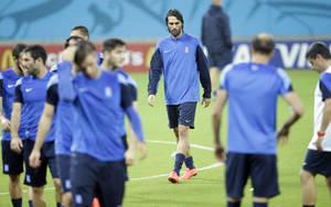 Photo - Greece's Giorgos Samaras, center, walks on the pitch during a training session of Greece in the Arena Pernambuco stadium, Recife, Brazil, Saturday, June 28, 2014. Greece will play Costa Rica in a World Cup round of 16 soccer match next June 29.(AP Photo/Andrew Medichini)