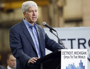 Photo - Michigan Gov. Rick Snyder speaks at the IDEAL Group Thursday, Jan. 23, 2014 in Detroit. Snyder announced a plan to ask the Obama administration to set aside thousands of work visas to entice talented immigrants to live and work in bankrupt Detroit. The Republican governor said he is seeking 50,000 work visas solely for the city over five years. (AP Photo/Paul Sancya)