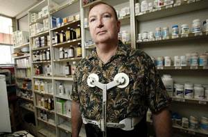 Photo - PHARMACIST / SHOOTING DEATH / ATTEMPTED ROBBERY / ATTEMPT: Dr. Jerome Ersland stands near medications at Reliable Discount Pharmacy, 5900 S Pennsylvania earlier this week in Oklahoma City, Thursday, May 21, 2009. Photo by Sarah Phipps, The Oklahoman  ORG XMIT: KOD