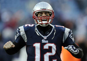photo - New England Patriots quarterback Tom Brady shouts as he takes the field before an NFL football game against the Miami Dolphins in Foxborough, Mass., Sunday, Dec. 30, 2012. (AP Photo/Charles Krupa)