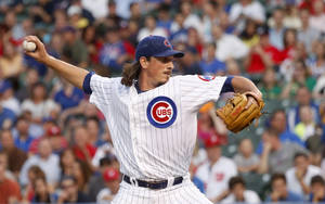 Photo - Chicago Cubs starting pitcher Jeff Samardzija delivers during the first inning of a baseball game against the Washington Nationals, Monday, Aug. 19, 2013, in Chicago. (AP Photo/Charles Rex Arbogast)