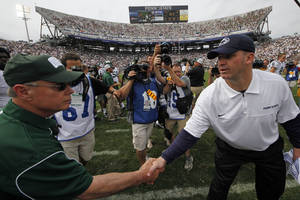 Photo -   Penn State head coach Bill O'Brien, right, shakes hands with Ohio head coach Frank Solich after an NCAA college football game at Beaver Stadium in State College, Pa., Saturday, Sept. 1, 2012. Ohio won 24-14. (AP Photo/Gene J. Puskar)