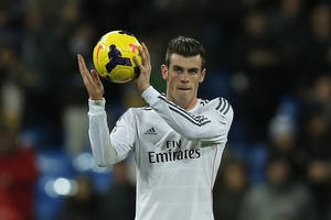 Photo - Real Madrid's Gareth Bale from Britain celebrates his hat-trick during a Spanish La Liga soccer match between Real Madrid and Valladolid at the Santiago Bernabeu stadium in Madrid, Spain, Saturday, Nov. 30, 2013. (AP Photo/Andres Kudacki)
