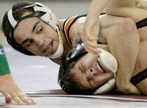 photo - OU / OSU / BEDLAM / COLLEGE WRESTLING / OKLAHOMA STATE UNIVERSITY: Oklahoma State's Jordan Oliver (left) wrestles Oklahoma's Jordan Keller during their dual at McCasland Field House on the University of Oklahoma campus in Norman, Okla., on Sunday, Feb. 20, 2011. Jordan Oliver won this match. Oklahoma State won the dual 24-9. Photo by John Clanton, The Oklahoman ORG XMIT: KOD