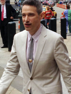 "Photo - Beastie Boys rapper Adam ""Ad-Rock"" Horovitz leaves federal court in Manhattan after testifying at a copyright trial stemming from a lawsuit the group brought against a beverage maker over the use of five of its songs in a video, Tuesday, May 27, 2014, in New York.  (AP Photo/Larry Neumeister)"