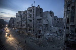 Photo - In this Thursday, Nov. 29, 2012 photo, night falls on a Syrian rebel-controlled area as destroyed buildings, including Dar Al-Shifa hospital, are seen on Sa'ar street after airstrikes  targeted the area last week, killing dozens in Aleppo, Syria. (AP Photo/Narciso Contreras)