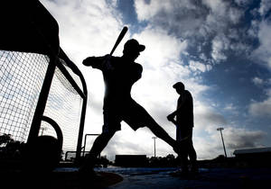 photo - Toronto Blue Jays catcher J.P. Arencibia is silhouetted as he takes part in batting practice during baseball spring training in Dunedin, Fla., on Tuesday, Feb. 12, 2013. (AP Photo/The Canadian Press, Nathan Denette)