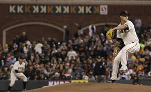 Photo - San Francisco Giants pitcher Matt Cain delivers against the Houston Astros during the seventh inning of a baseball game in San Francisco, Wednesday, June 13, 2012. (AP Photo/Jeff Chiu) ORG XMIT: FXPB112