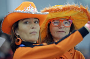 Photo - Dutch skating fans watch the men's 5,000-meter speedskating race at the Adler Arena Skating Center during the 2014 Winter Olympics, Saturday, Feb. 8, 2014, in Sochi, Russia. The Netherlands' won all gold, silver and bronze. (AP Photo/Patrick Semansky)