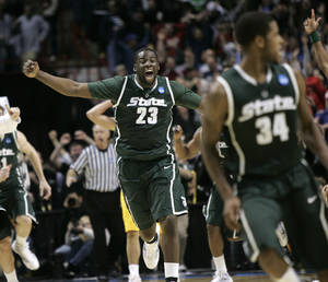 photo - Michigan State's Draymond Green (23) celebrates as he rushes to Michigan State's Korie Lucious, right, after Lucious hit the winning basket after a pass from Green in the second half of an NCAA second-round college basketball game in Spokane, Wash., Sunday, March 21, 2010. Michigan State beat Maryland 85-83. (AP Photo/Don Ryan) ORG XMIT: SPO112