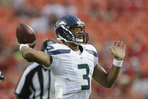 photo -   Seattle Seahawks quarterback Russell Wilson (3) passes to a teammate during the first half of an NFL preseason football game against the Kansas City Chiefs in Kansas City, Mo., Friday, Aug. 24, 2012. (AP Photo/Charlie Riedel)