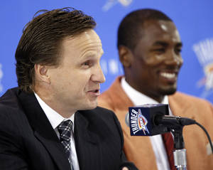 Photo - Oklahoma City Thunder NBA basketball team head coach Scott Brooks talk about Serge Ibaka, right, during a press conference about Ibaka's new contract to keep him with the Thunder, at the Boys and Girls Club of Oklahoma County, Monday, Sept. 10, 2012. Photo by Nate Billings, The Oklahoman