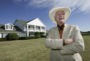"photo - FILE - In this Oct. 9, 2008, file photo, the late Actor Larry Hagman poses in front of the  Southfork Ranch mansion made famous in the television show, ""Dallas"",  in Parker, Texas. Tourists have been flocking to Southfork Ranch since the early years of the classic series, which ran from 1978 to 1991. And a new ""Dallas"" starting its second season on TNT on Monday and the recent death of the show's star, Larry Hagman, who legendarily played conniving Texas oilman J.R. Ewing, have also spurred fans to visit. (AP Photo/Tony Gutierrez, file)"