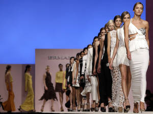 Photo -   Models wear creations part of the Ermanno Scervino women's Spring-Summer 2013 collection presented in Milan, Italy, Thursday, Sept. 20, 2012. (AP Photo/Luca Bruno)